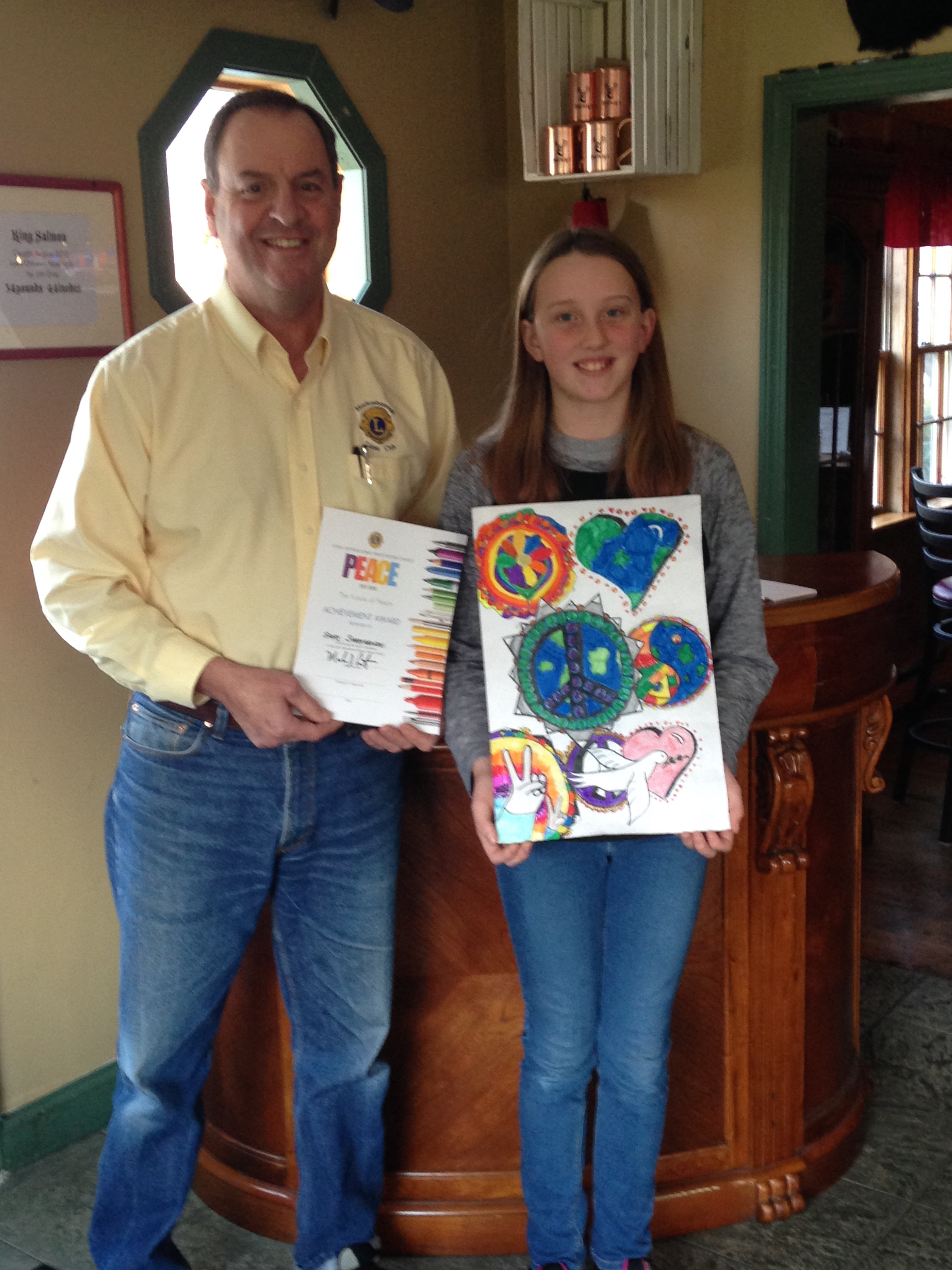 Lions Club President Mark Cotrupi Pictured With Sadey And Her Poster Said He Was Impressed By The Colorfulness Creativity Of
